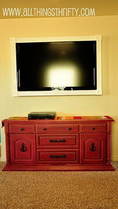 I love that look with the frame around the tv!