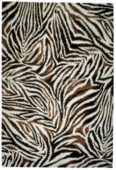 The Rug Company fashionably collaborated with Diane von Furstenberg to create this hand-knotted wool zebra-print rug. #Luxe