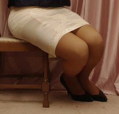 Visible Garter Bumps Under White Half Slip Sheer Stockings and Black High Heels