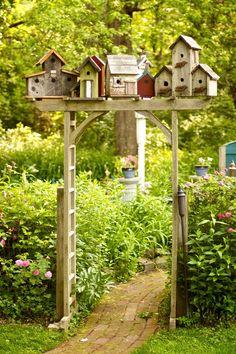 Bird House Village on Garden Arbor....I LIKE THIS!!! I think I may do this