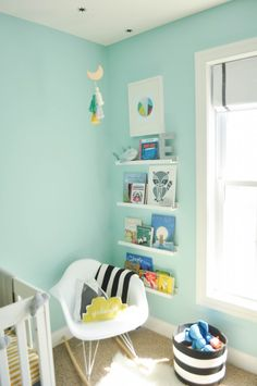 Big brother reading nook in our teal, grey, black, white and yellow modern industrial nursery with clouds.