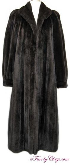 """Ankle Length Ranch Mink Coat #RM726; $2000.00; Excellent Condition; Size range: 6 - 10.This is a gorgeous genuine natural ranch mink fur coat in the luxuriously long ankle length. It has Graf's Furs label and features a shawl collar and banded bracelet cuffs.  If not for having a monogram, it would be listed as """"like new"""" condition. It is a spectacular fur coat that you will be proud to own."""