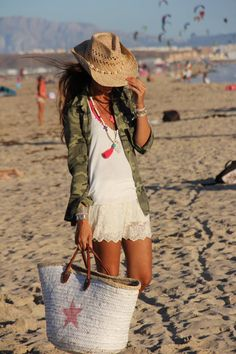 Oversized camo jacket, little lace shorts, Tibetian beads & straw western style beach hat. Cute beach outfit for when the temperature drops.