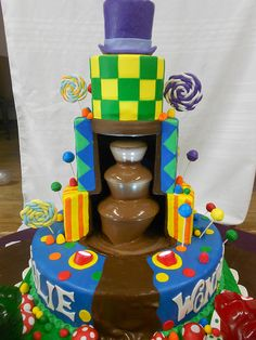 """awesome Charlie and the Chocolate Factory Cake ~ Cake with a running chocolate fountain built into the frame.  Adorned with edible handmade  candies"" ""Edible handmade candies""... eh. But the idea of chocolate fountain is great :-) I would have done it differently, though."