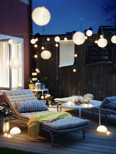 A relaxing setting outdoors to enjoy day and night - powered by sunlight. Designed by IKEA.