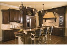 In this gorgeous Olmstead kitchen, all of nature's beauty can be savored in this rich space.To see the actual floor plans for this home, click here: http://www.thehousedesigners.com/plan/olmstead-7804/