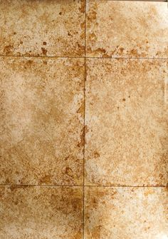 Lustre Tile Wallpaper Metallic bronze tile wall paper with cracked, aged glaze effect.