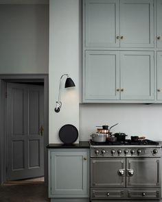 I do love myself a hint of grey cabinets