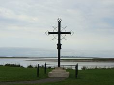 This is the Deportation Cross in Grand Pre, Nova Scotia that marks the site of embarkation of over 2,000 Acadian farmers and tradesmen and their families in 1755. Our replica of the Grand-Pré Deportation Cross is in St Martinville, Louisiana.