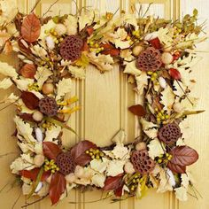 Embellish a square store-bought magnolia wreath with color-coordinated real and faux materials, including twigs, seedpods, nuts, berries, wheat and leaves. More Thanksgiving decorating: http://www.midwestliving.com/holidays/thanksgiving/easy-ideas-for-thanksgiving-decorating/?page=15,0