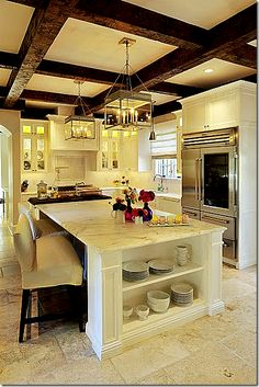 love the contrast of the wood beams & marble countertop
