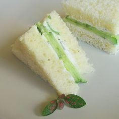Cucumber Tea Sandwiches Makes 24 sandwiches  2 seedless cucumbers, ends trimmed 12 slices white sandwich bread 6 ounces whipped cream cheese 1 1/2 tablespoons finely chopped fresh dill, optional  Cut each cucumber crosswise into 4 equal pieces. Thinly slice each cucumber piece lengthwise into strips. Place the bread slices on a work surface and spread with a thin layer of cream cheese. Divide the cucumber and dill (if desired) evenly among 6 of the slices