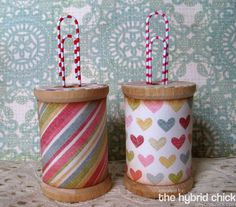 Old spools  and paper clips. for notes and photos!  Awesome Mod Podge project.