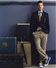 Dark blue vest with yellow-striped tie, light brown pants, navy shoes