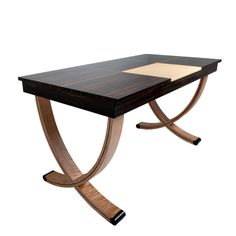 This is an exquisite writing desk in ebony and some nicely figured maple  by Jiri Kalina in North Carolina. Nice work! Check it out on etsy for more pix.