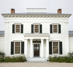 love a white house with black shutters.
