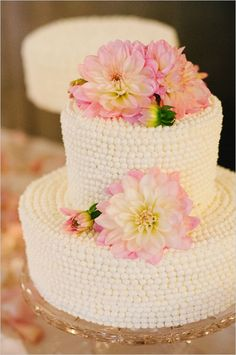 White wedding cake --- The piping on the sides creates such a neat look, almost like strands of pearls wrapped around the cake