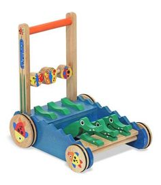 {Wooden Chomp & Clack Alligator Push Toy} This multisensory wooden push toy encourages walking and discovery. Graphic details feature cattails on the handle supports, fish on the wheels and spinning butterfly and ladybug beads.