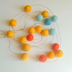 Felt Ball Garland in yellow, orange, blue. #ApartmentTherapy