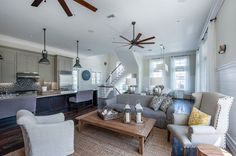 Open concept living area/kitchen design idea by Chancey Designs. Beautiful coastal elements