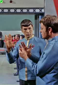"""Spock Teaching McCoy how to offer the vulcan greeting. """"Live long and Prosper"""""""