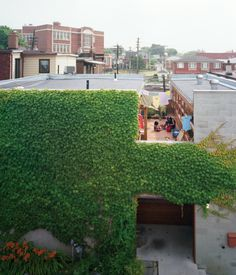A wide cut across the top of this house in Toronto made room for a second-floor courtyard where the residents and their kids can catch some sun but maintain their privacy. On the ground level, the front door is tucked into an ivy-covered alcove lined with ipe, a material used throughout the house. Photo by Juliana Sohn. text & image via dwell