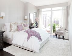 Another soft, cozy bedroom.  I like the neutral color scheme with the lavender accent.  The nice thing is that the lavender can be changed out for any other color and give you a totally different look and feel.