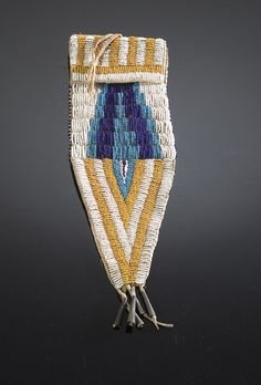 suchasensualdestroyer:    Ute (Nevada or Utah), Tail Bag, beads/tin cones/leather, c. 1890.