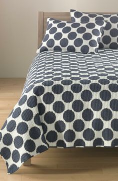 Spotted! Cute blue and white quilt.