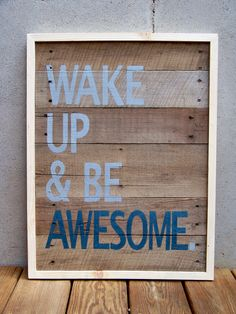 """Pieces of a recycled wooden shipping pallet were cut, lightly sanded, painted in washes of brown acrylic paint and assembled into the """"canvas"""" for this original piece of art. The message """"WAKE UP & BE AWESOME"""" was then carefully hand painted on the wood planks. The colors used are a medium shade of gray and navy blue. A hand made natural wood frame completes the piece. Art On Recycle Wood, Hands Painting, Reclaimed Wood, Inspiration, Wood Painting Quotes, Pallets Wood, Quotes For Canvas Painting, Painting Signs, Recycle Wood Painting"""