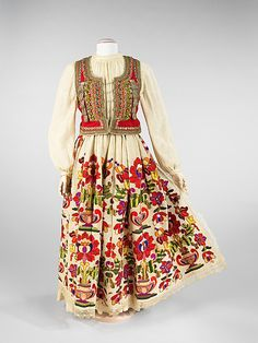 Ensemble, second quarter 20th century. Bulgarian. The Metropolitan Museum of Art, New York. Brooklyn Museum Costume Collection at The Metropolitan Museum of Art, Gift of the Brooklyn Museum, 2009; Gift of John C. Monks, 1966 (2009.300.24a–c) | The embroidery nearly covers the surface of the skirt and combines both stylistic and naturalistic elements in the depiction of realistic irises and oversized potted flowers with their bold, definitive urns. #iris #flower