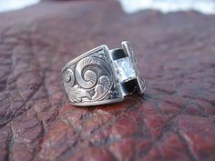 Custom made western wedding rings by Travis Stringer. Contact us on FaceBook. (Ring #1)