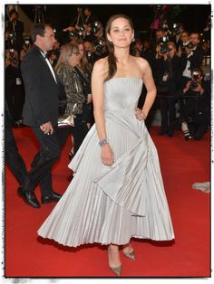 """I'm not always a fan of """"big"""" dresses, and glittery shoes typically look a few seasons back for me. But put it altogether on Marion Cotillard and the result is sublime.  Styled by the wrong hands, a plisse pleated dress like this can be overwhelming. But the simplicity and ease of Cotillard's hair, makeup, and confidence make this Dior Haute Couture look stellar.  Another lesson learned in that it's not what you wear but how you wear it.  #cannes"""