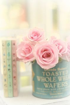 Pretty Pastel Flowersin an old tin