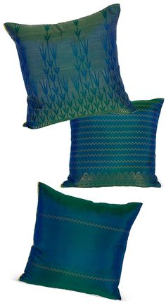 It will be filled with teal color pillows.    One Sari, Many Pillows - saris have enough yardage and different patterns to make a set of coordinating pillows like these from One Kings Lane