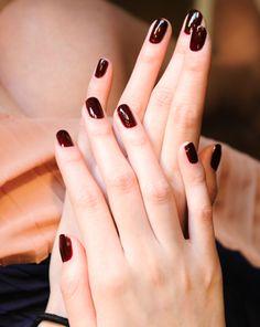 shiny oxblood manicure