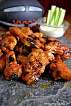 Cranberry hot wings; easy BAKED hot wings recipe using canned cranberry sauce and sriracha!