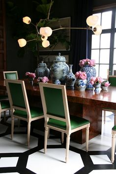 Kelly Green leather chairs. modern decor, dining room, black and white floor