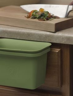 Scrap Happy - Slip the Scrap Happy's wire handle into a drawer and scrape in food scraps, then pop in the freezer. When it's full, empty into the compost bin. Ideal for kitchens where counter space is at a premium.