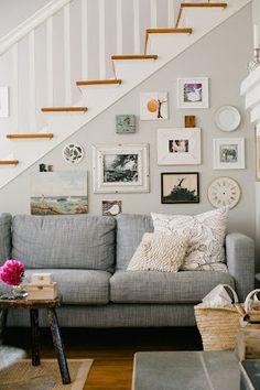 Grey linen couch & art wall.