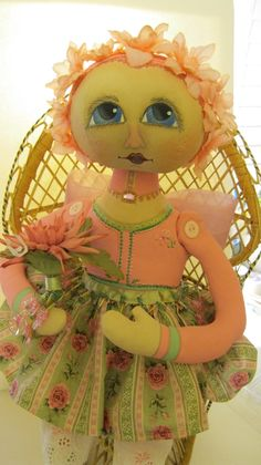 Made to order doll from Raggedyrhondas.com send me an email and will be happy to talk with you. This is the springtime flower girl.