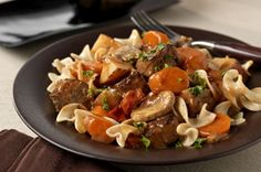 Old-Fashioned Beef Stew recipe-Prep before work and come home to mouthwatering aromas and end-of-day deliciousness. Tender beef, hearty vegetables and a savory sauce top noodles for a smart, big-flavor meal. #slowcookerrecipes