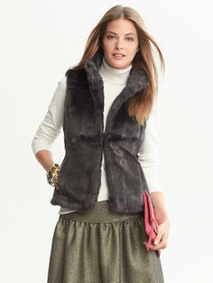 130.00 Banana Republic Cozy faux fur gives an opulent touch to our shaped feminine vest. Standing collar. Hidden hook and eye closure. On seam pockets. Fully lined. Hits at the hip. #Fall #Fashion