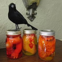 Create a creepy Halloween mantle including these mad scientist specimen jars.