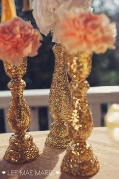 Decorating vases with glitter or rhinestones or paper/glue could be way cheaper then buying them all and you get to be unique #gold wedding reception ... Wedding ideas for brides, grooms, parents & planners ... https://itunes.apple.com/us/app/the-gold-wedding-planner/id498112599?ls=1=8 … plus how to organise an entire wedding ♥ The Gold Wedding Planner iPhone App ♥ wedding receptions, gold weddings, gold and pink decor, diy gold wedding decor, glitter gold vases, wedding planners, gold glitter decorations, gold and pink wedding decor, pink and gold wedding