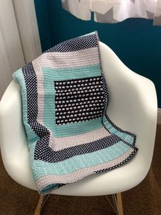 Another interesting modern baby quilt, black, white, grey and aqua!