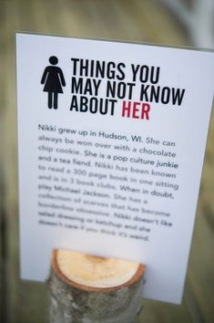 """Her"" on one side and ""Him"" on the other. Cute idea for guests who may not know one or the other very well."