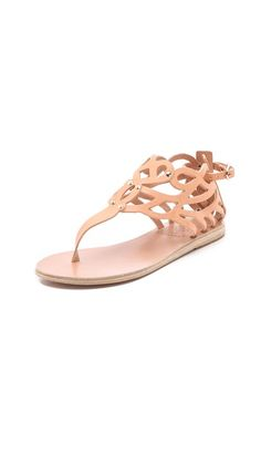Wow, very cool thong sandals. Perfect for breezy skirts + maxi dresses.