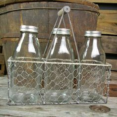 Porches, kitchens, and tables: this three-bottled chicken wire basket is the perfect addition for anything rustic chic.