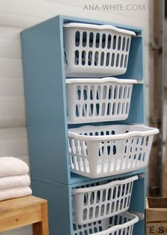 Laundry basket holder for the laundry area -- each person gets their own basket for clean clothes